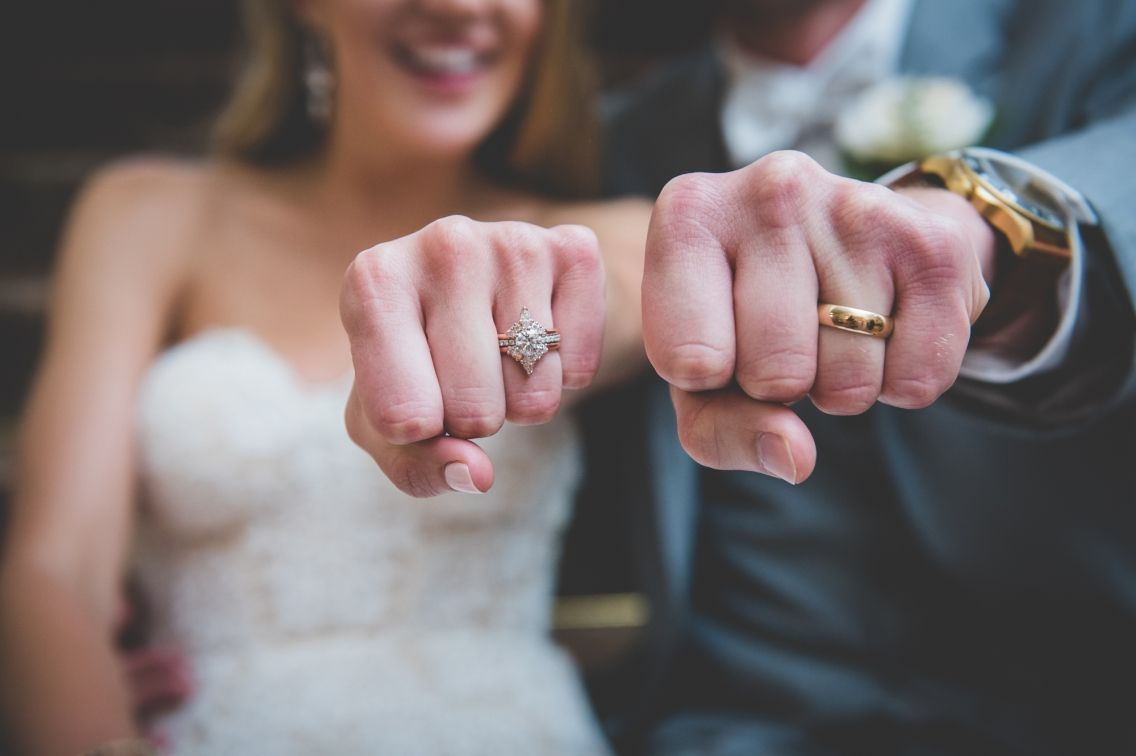 Bride And Groom Show Off Wedding Rings Fun Photo