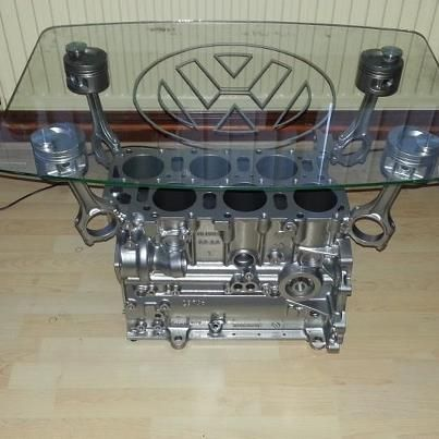 a perfect vr6 engine block being humiliated as a coffee table