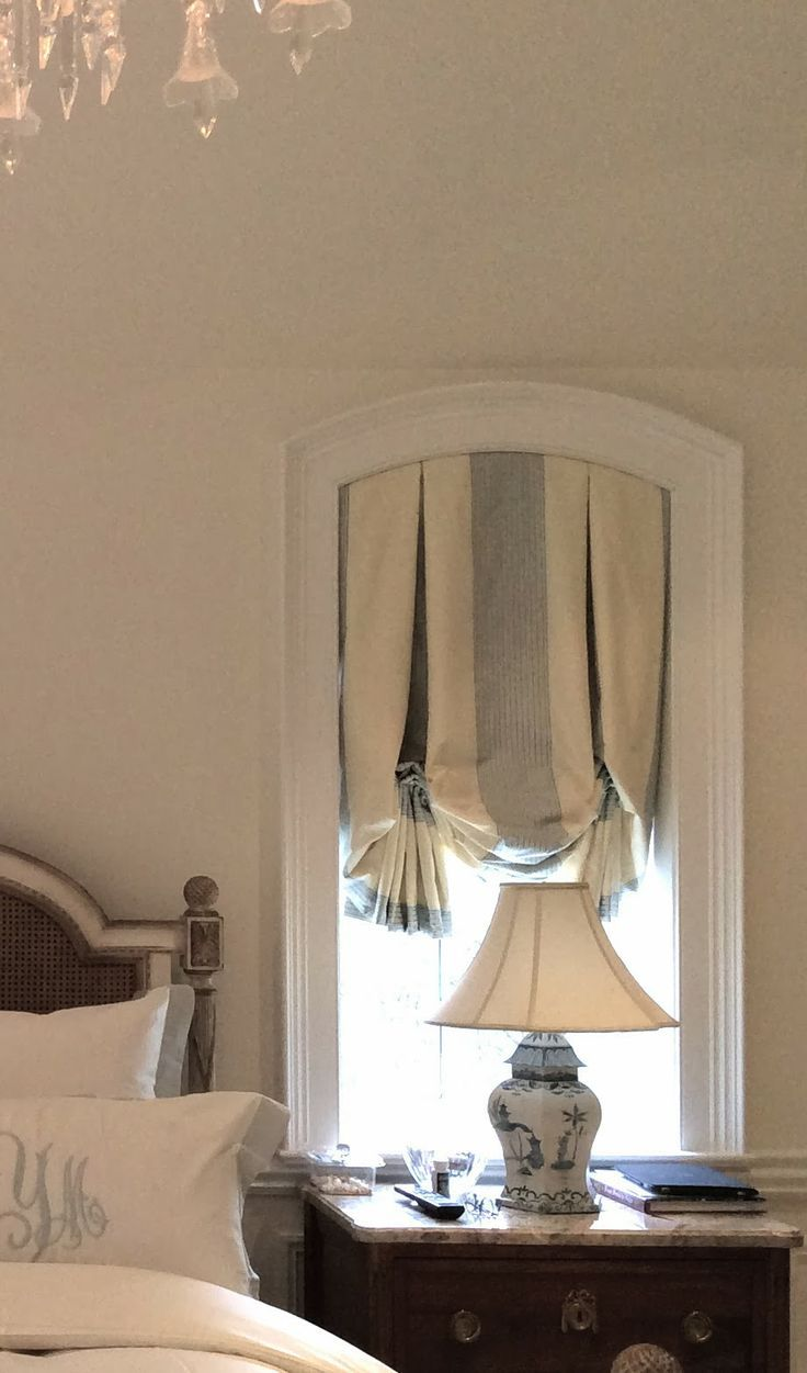 Window coverings arched windows  love striped silk subtle sorbet colors this window dressing looks