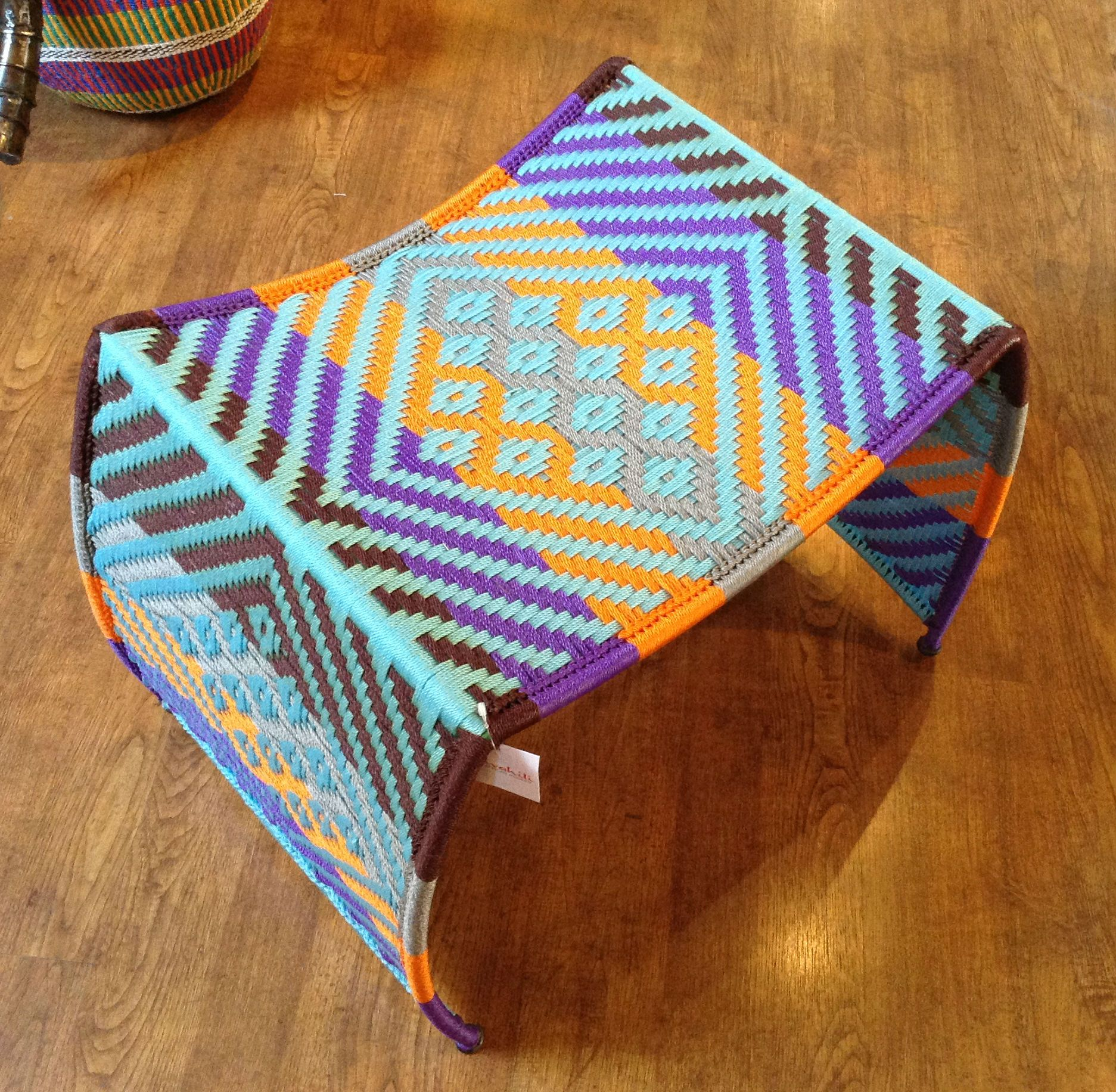 Multi Color Stool hand woven in Senegal, East Africa.  Swahili African Modern Fair Trade Gifts and Home Decor #fairtrade #wovenfurniture