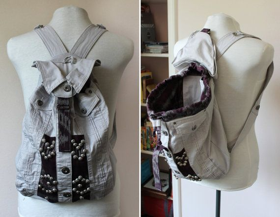 Grey denim embellished backpack with purple accents and embellishments