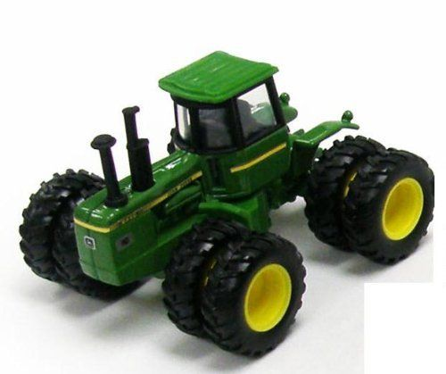 """Deere State Tractor Series - North Dakota 8440 by RC ERTL. $12.99. North Dakota State Commemorative Tractor 8440 - 22nd in Series - 37679 RC2 ERTL John Deere - JD State Farm Tractor Assortment 6. This diecast collectible tractor is 1:64 scale die-cast metal model. Individually blister carded. Card size: 6.25"""" x 7"""". These farm tractors are manufactured by RC2 Brands."""
