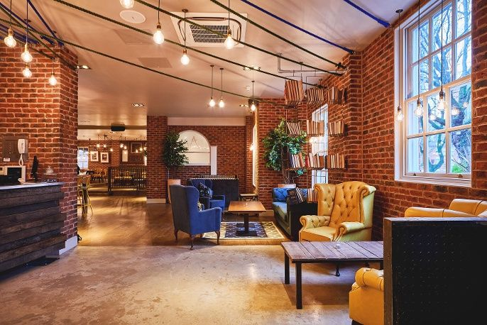 Quirky and eclectic bar design. Exposed brick, yellow and cobalt ...