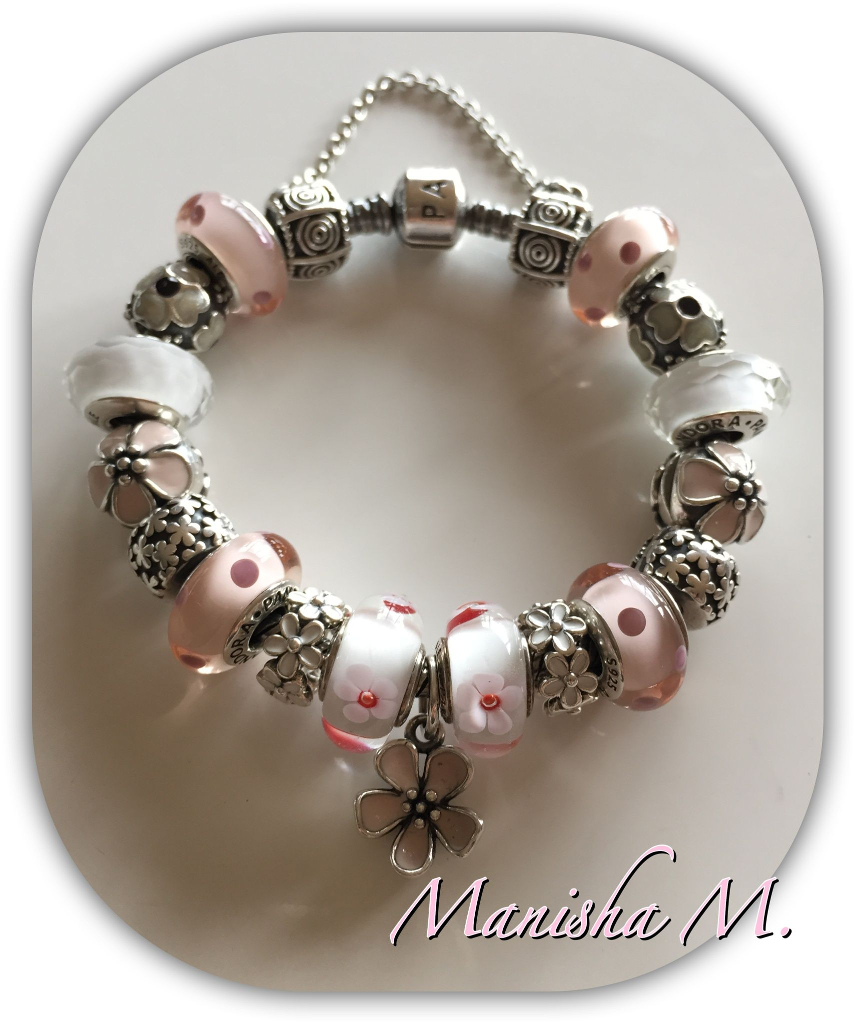 Pandora Bracelet With Select Pink Murano Daisy Spacers