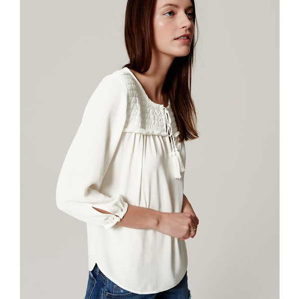It's all in the details of this fluid blouse - a quilted yoke, fringe trim  and tasseled ties channel wanderlust chic. Split neck with tasseled ties.  blouson ...