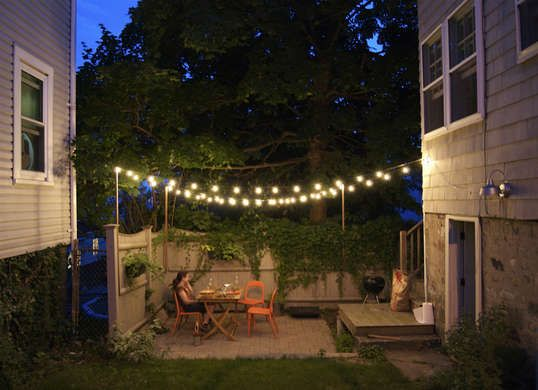 Improve A Tiny Backyard Patio With Playful String Lights