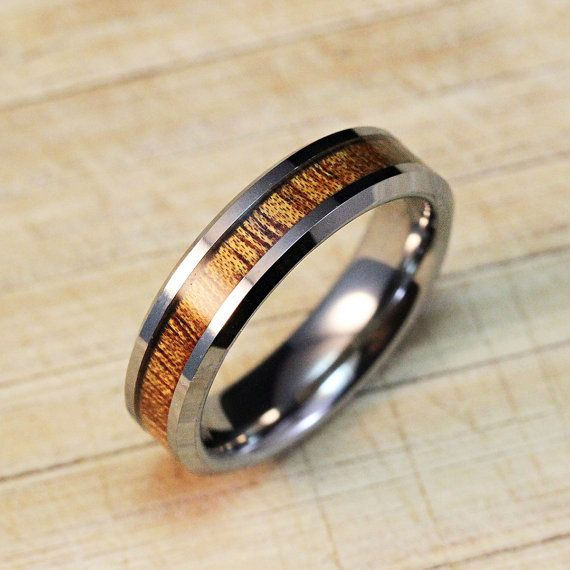 Hey, I found this really awesome Etsy listing at https://www.etsy.com/listing/167542790/tungsten-carbide-ring-with-koa-wood