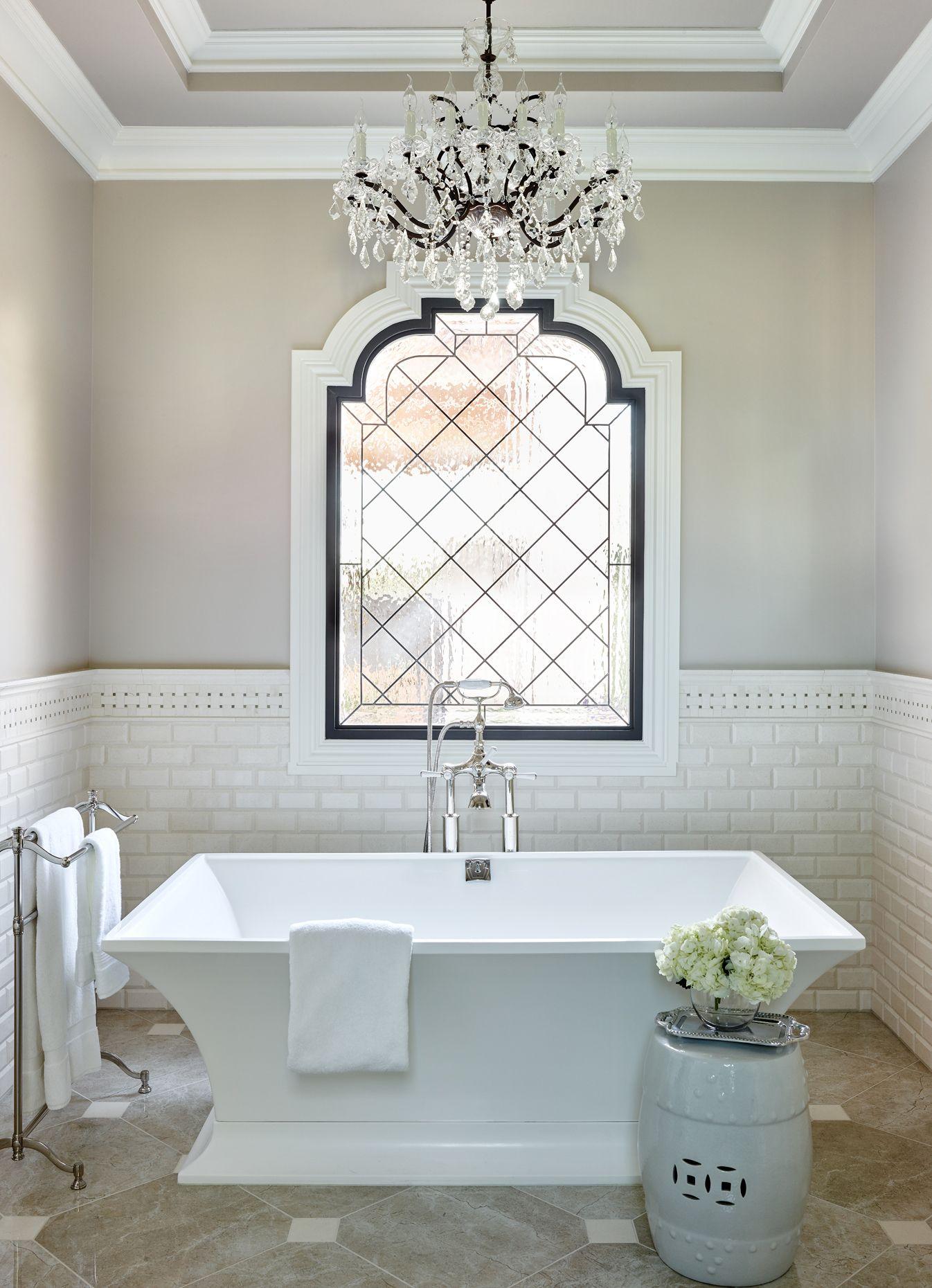 Luxury Bathroom with Chandelier over tub  Amazing