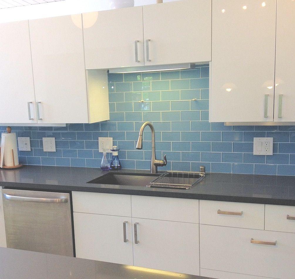 Sky Blue Glass Subway Tile Backsplash For Modern Kitchen With White Cabinets And Un Kitchen Backsplash Photos Modern Kitchen Backsplash Blue Backsplash Kitchen