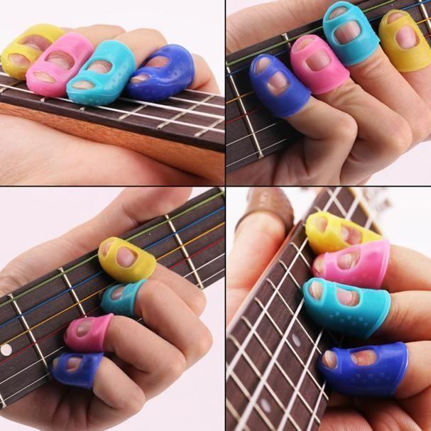 4pcs guitar fingertip protectors finger guards for ukulele guitar accessories unbranded. Black Bedroom Furniture Sets. Home Design Ideas