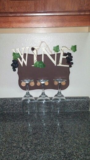 Create your own wine glasses holder using old wine corks! Less than $5