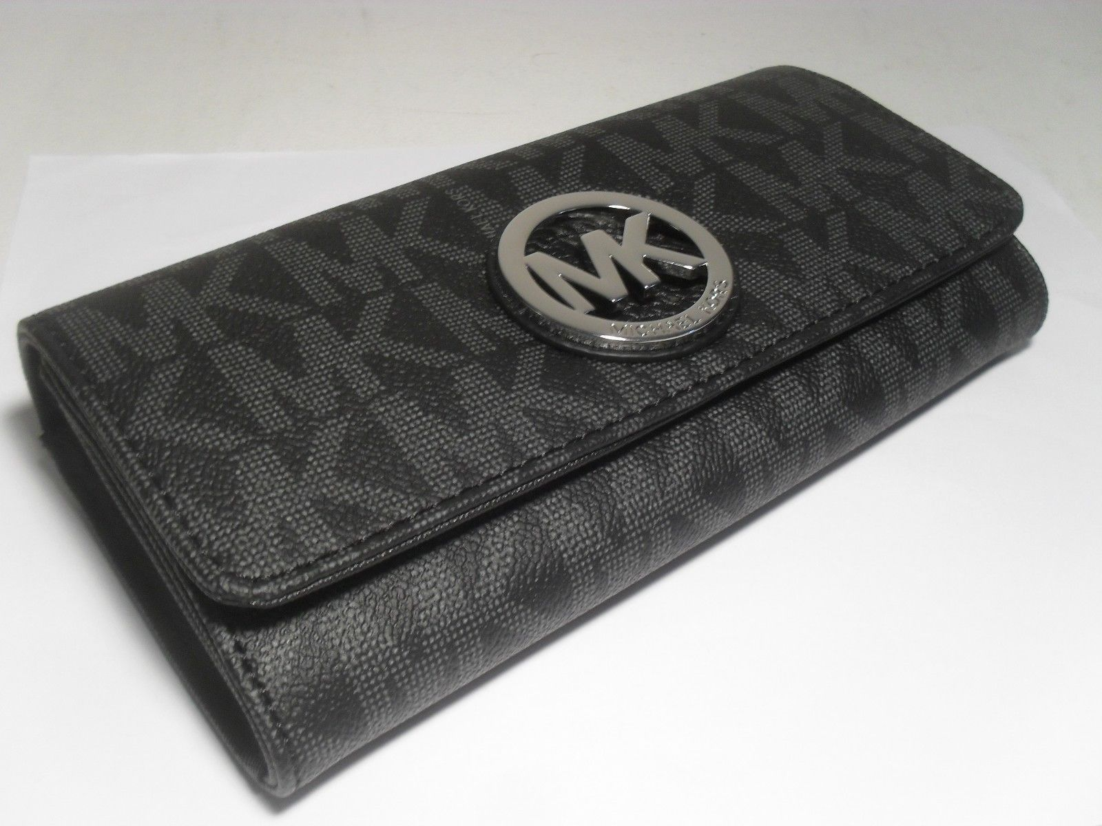 ef295abd80bacc NWT Michael Kors Black PVC MK Signature Fulton Flap Continental Carryall  Wallet