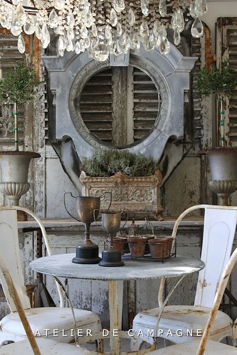 A Rather Beautiful Display Of Furniture And Objects In The French Country  Manor House Style. Rusted Metal Furniture, Lighting Fixtures, And Furniture  Give ...