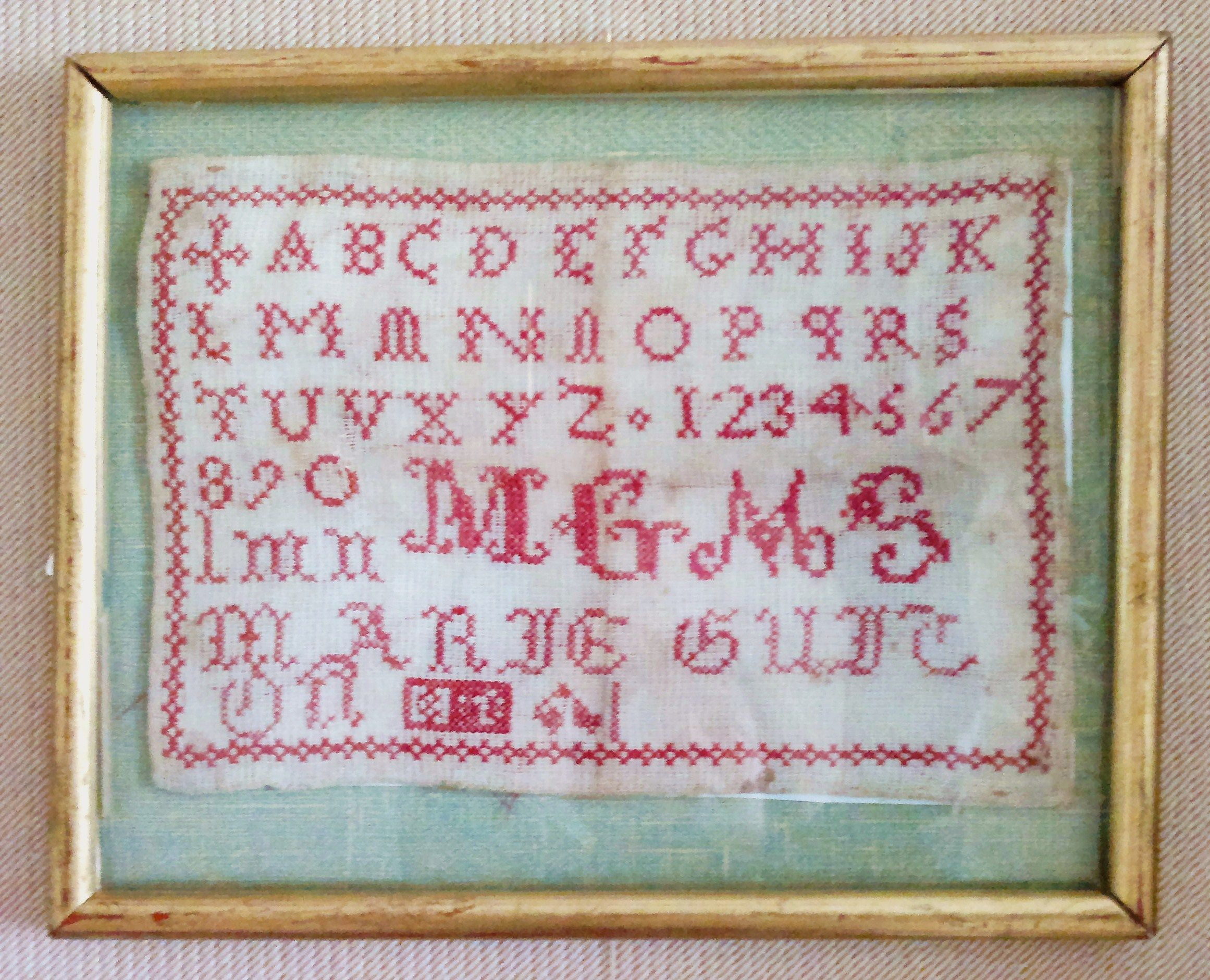 Abécédaire de Marie Guitton (une de mes arrière-grand-mères), 8 ans - 1898 - Tours - France. Cross stitch sampler made by one of my grand-grand mothers as a school work, at the age of 8, in 1898. Town of Tours - France.