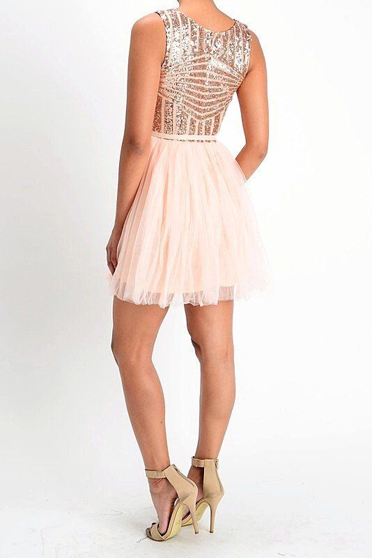 1664c2545866 A sparkling sequin scoop neck bodice gives this Darlin rose gold short dress  a festive style that is perfect for any special occasion.