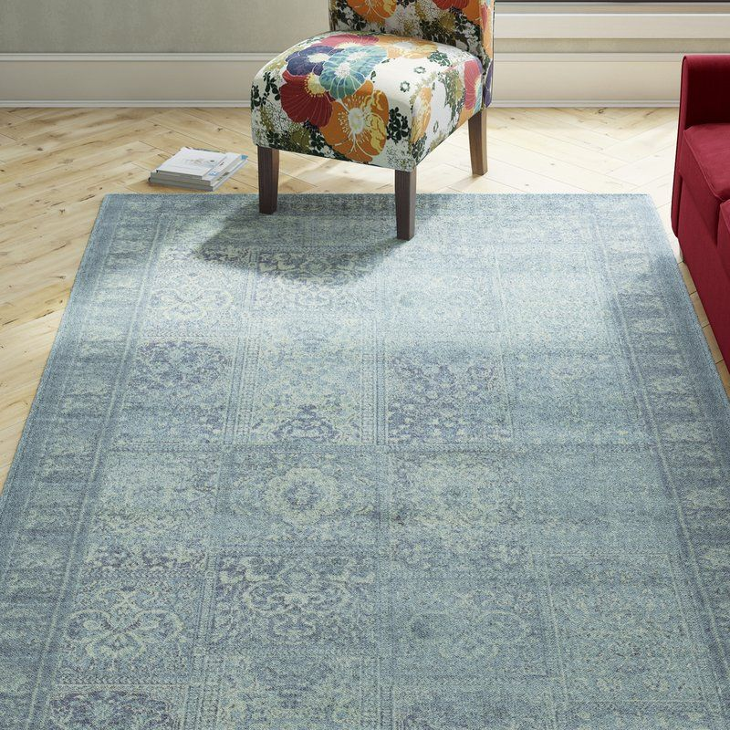 Channelling vintage design influences, this blue-toned rug features