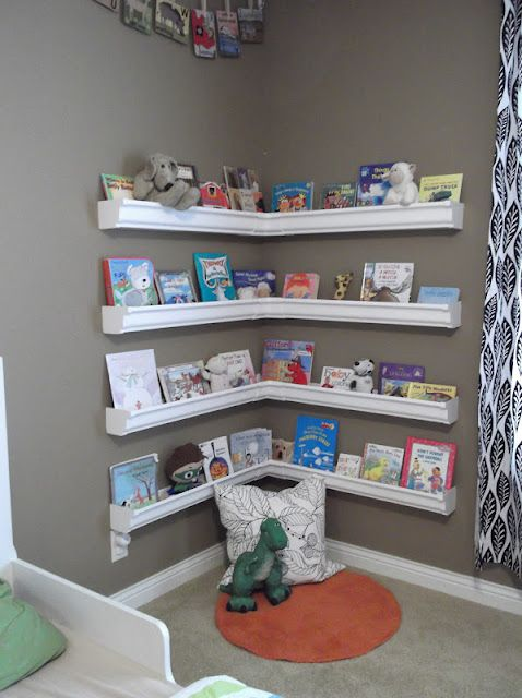 We've all seen rain gutter shelves, but I fell in love with them all over again when placed in a corner like this. Add a little bean bag or small chair & Ta Da! Instant reading corner