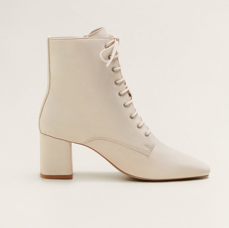 156329a1a44 Love a classic lace-up boot  Opt for a white pair with a comfortable heel  that you know you ll wear 24 7 once cold weather hits.