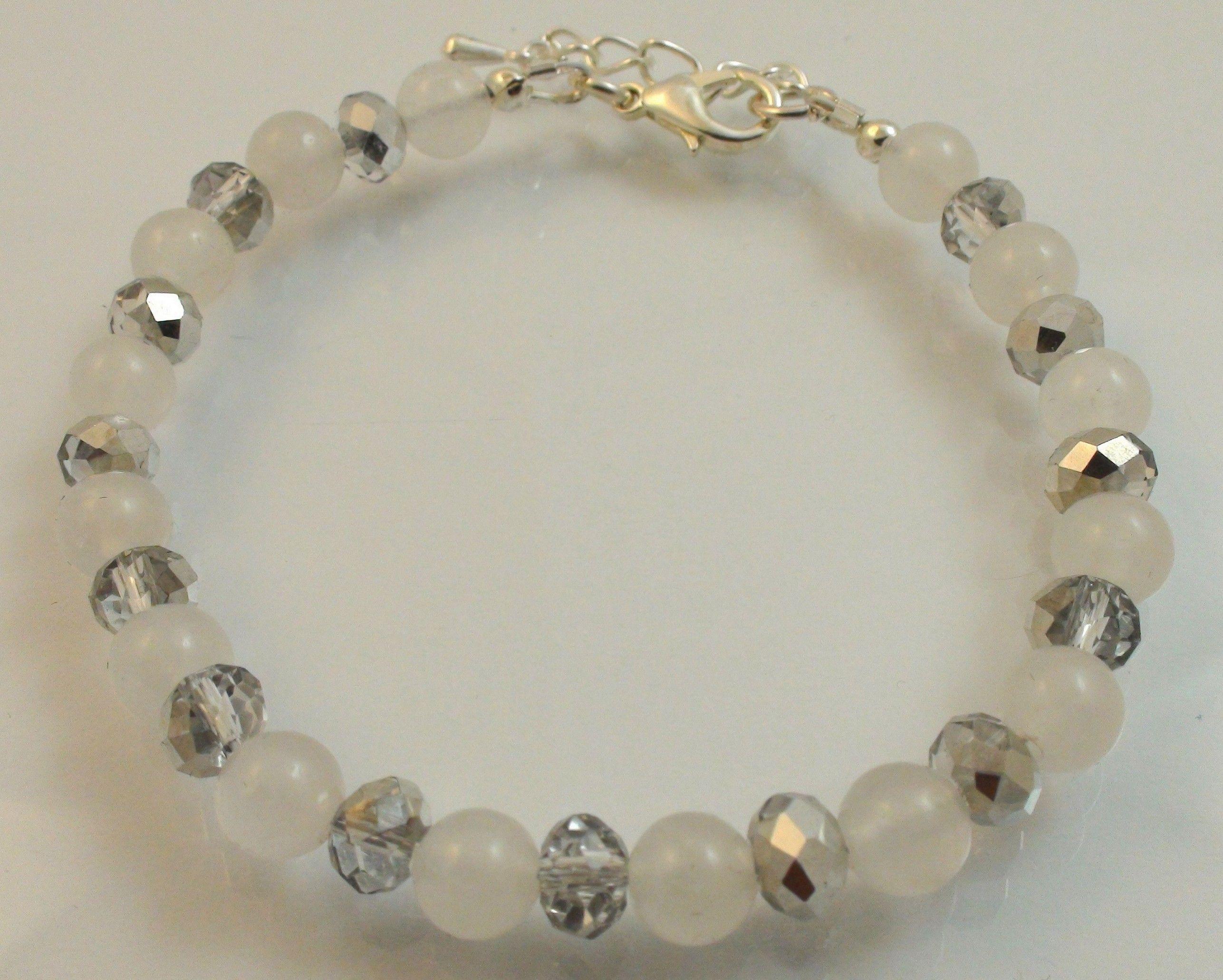 White Jade Bracelet Elegant white jade bracelet with silvery Austrian crystal spacer beads.
