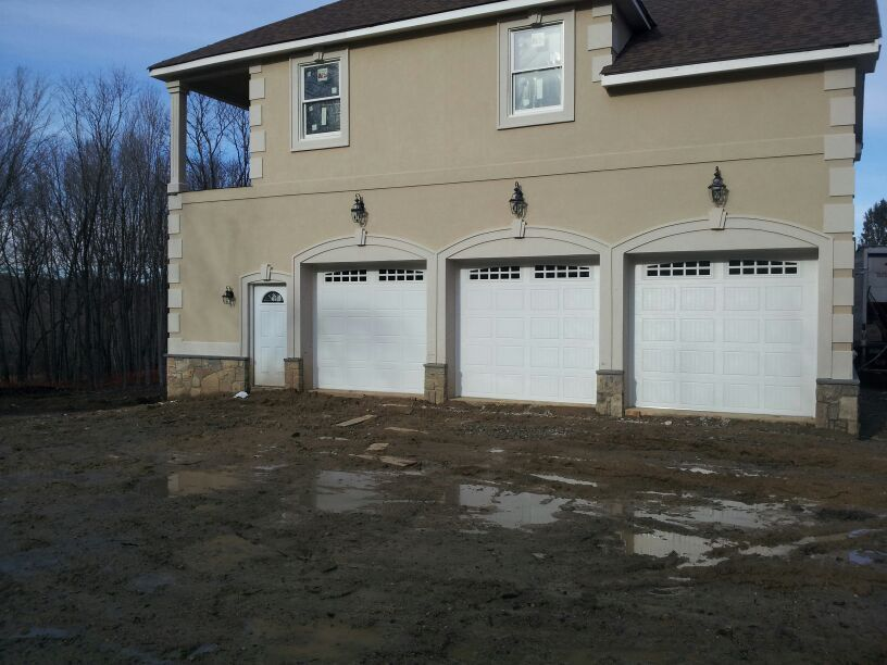 Dutchess Overhead Doors Installed These Raynor Showcase Garage Doors These Are A Sturdy Insulated Garage Do Garage Doors Door Installation Raynor Garage Doors