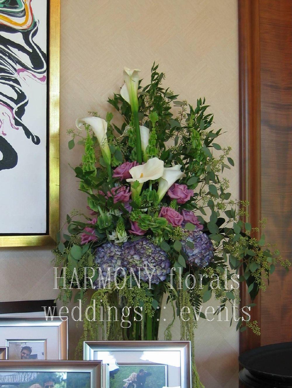 Escort card table arrangement #escortcard #callalilies #weddingdecor