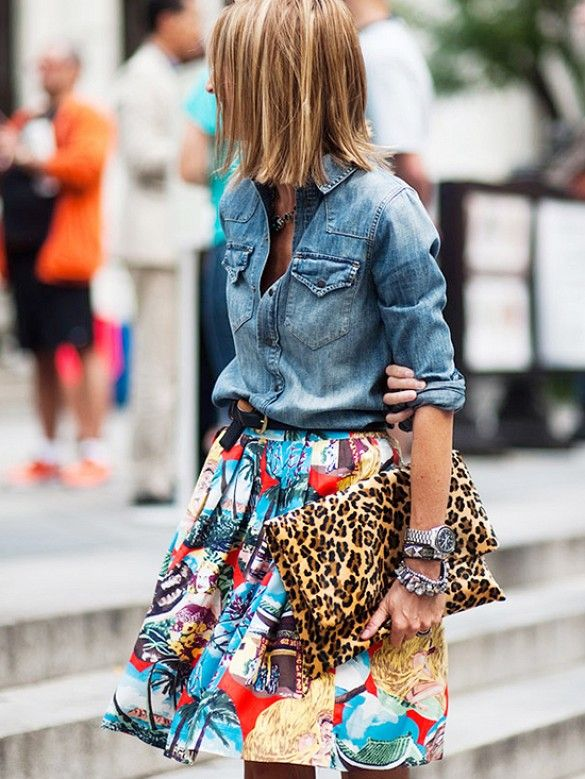 Pair A Chambray Shirt And Animal Print Clutch With A Tropical Inspired Skirt For A Fun Date Night Outfit