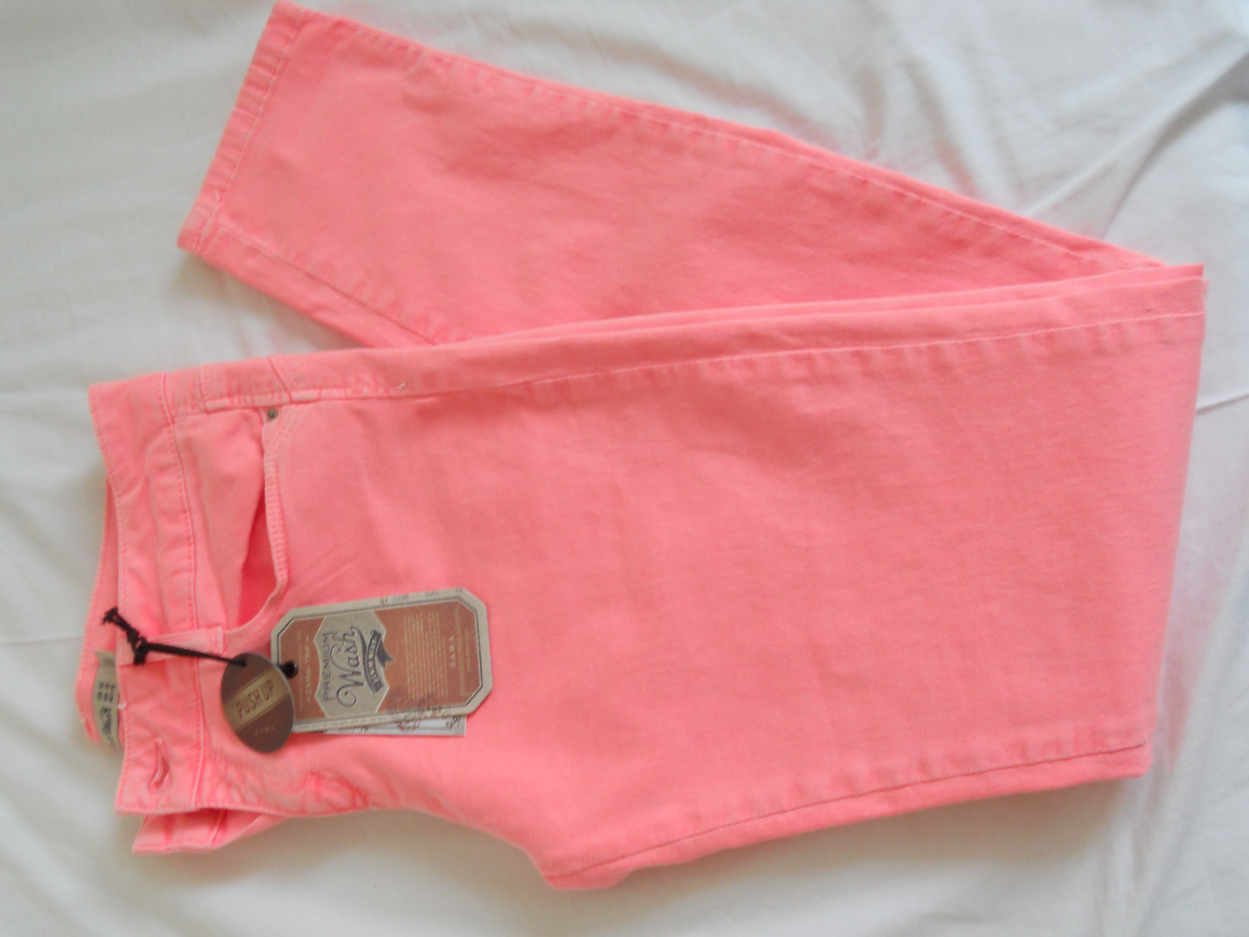 Pink neon jeans.