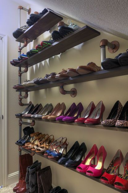 """Industrial pipe shelving for under-stairs storage   NOT that i have this many shoes, I just love the steampunky look of the pipe...somehow appropriate to stairs down to the basement """"lab"""". LOL"""