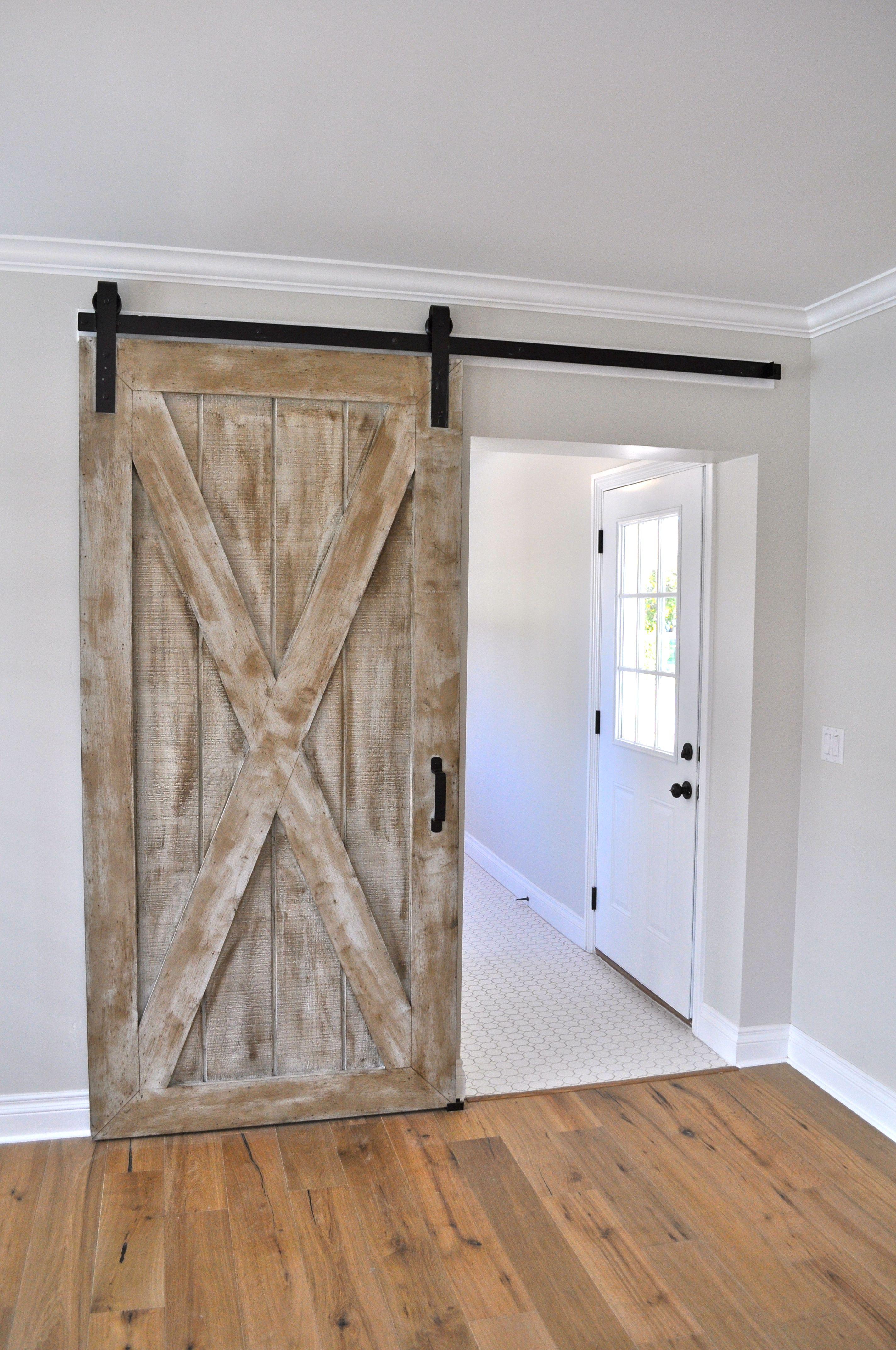 Custom made sliding barn door by rafterhouse rustic