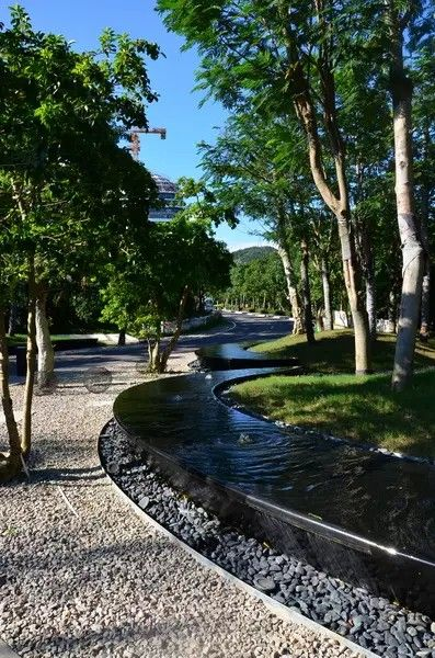 Summer Style Gorgeous Flowing Raised Stream With Rock And Pea Gravel Landscape Architecture Design Waterscape Design Landscape Design
