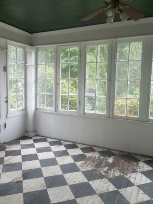 painted checkerboard floors and oh those windows