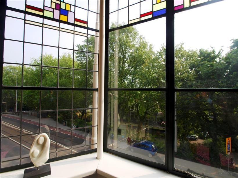Smalle metalen raamlatten appartement te koop for Honingerdijk rotterdam