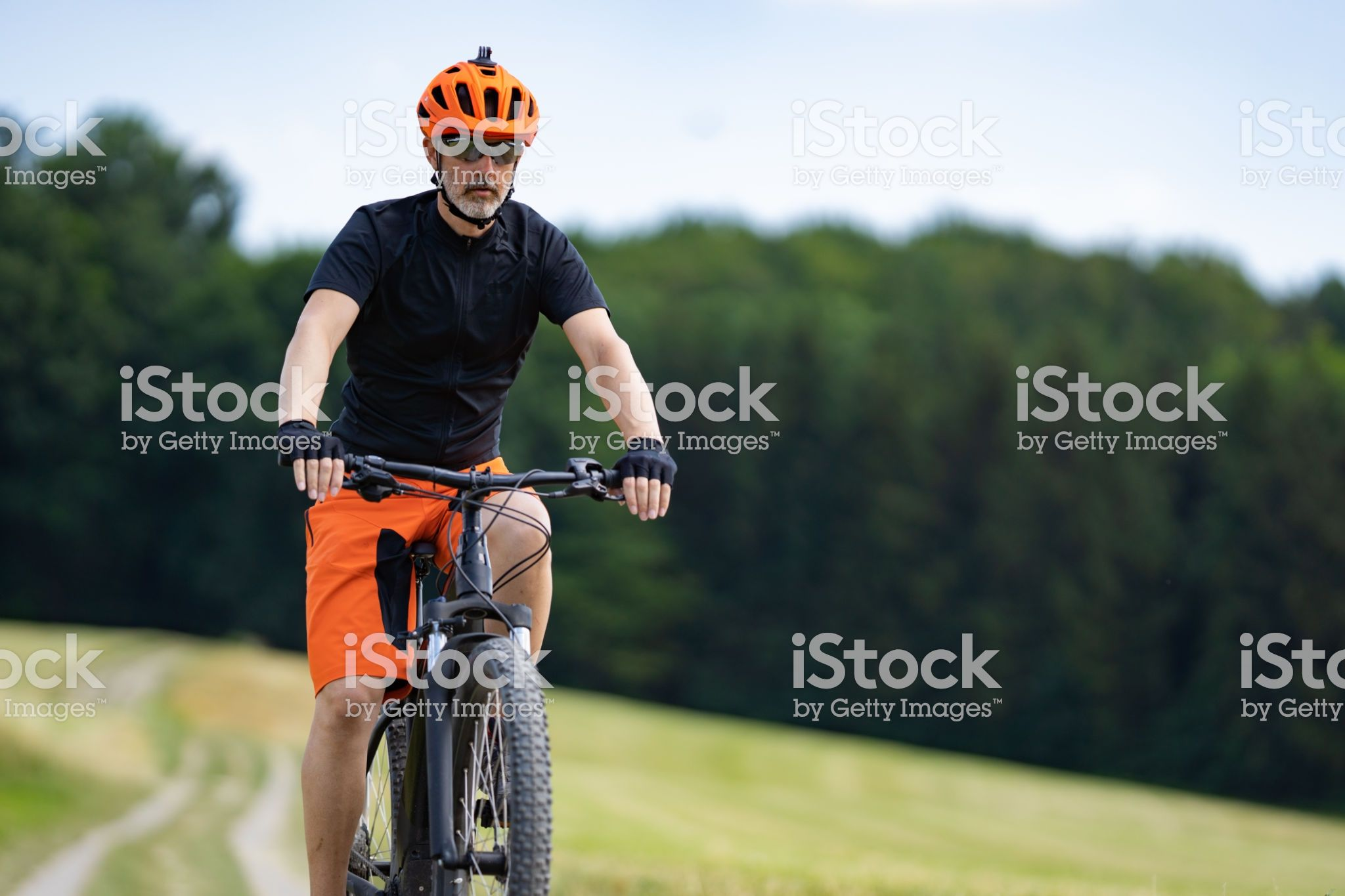 46 Years Old Fit Man With Bike Helmet Biking Outdoors In Rural