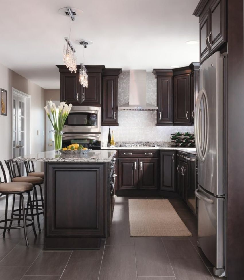 Classy Kitchen Design Ideas Glamorous Touches Like A Stainless Hood And Crystal Pendants Give Kemper Brown Kitchen Cabinets Kitchen Design Kitchen Flooring