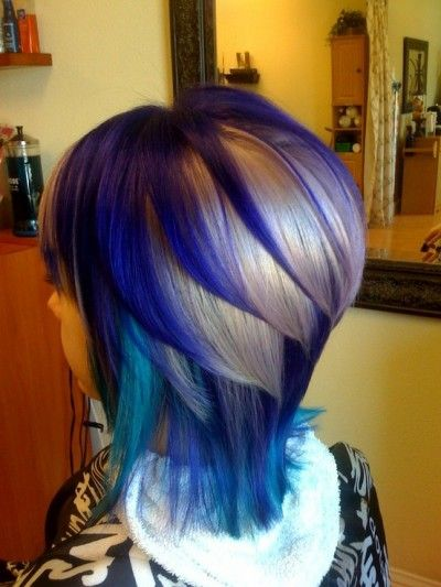 Beautiful hairstyle with layers and blue highlights