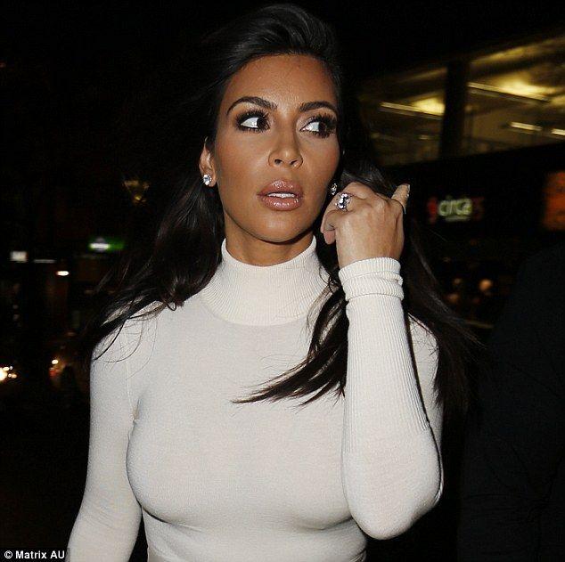 Kim Kardashian steps out in white frock