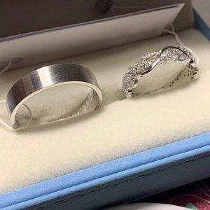 Matching wedding bands made of two colors of gold. Wedding rings set