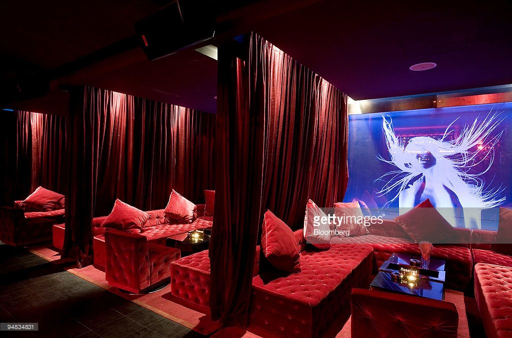 Red drapes serve as partitions in the lounge area of Bar Rouge, in Shanghai…