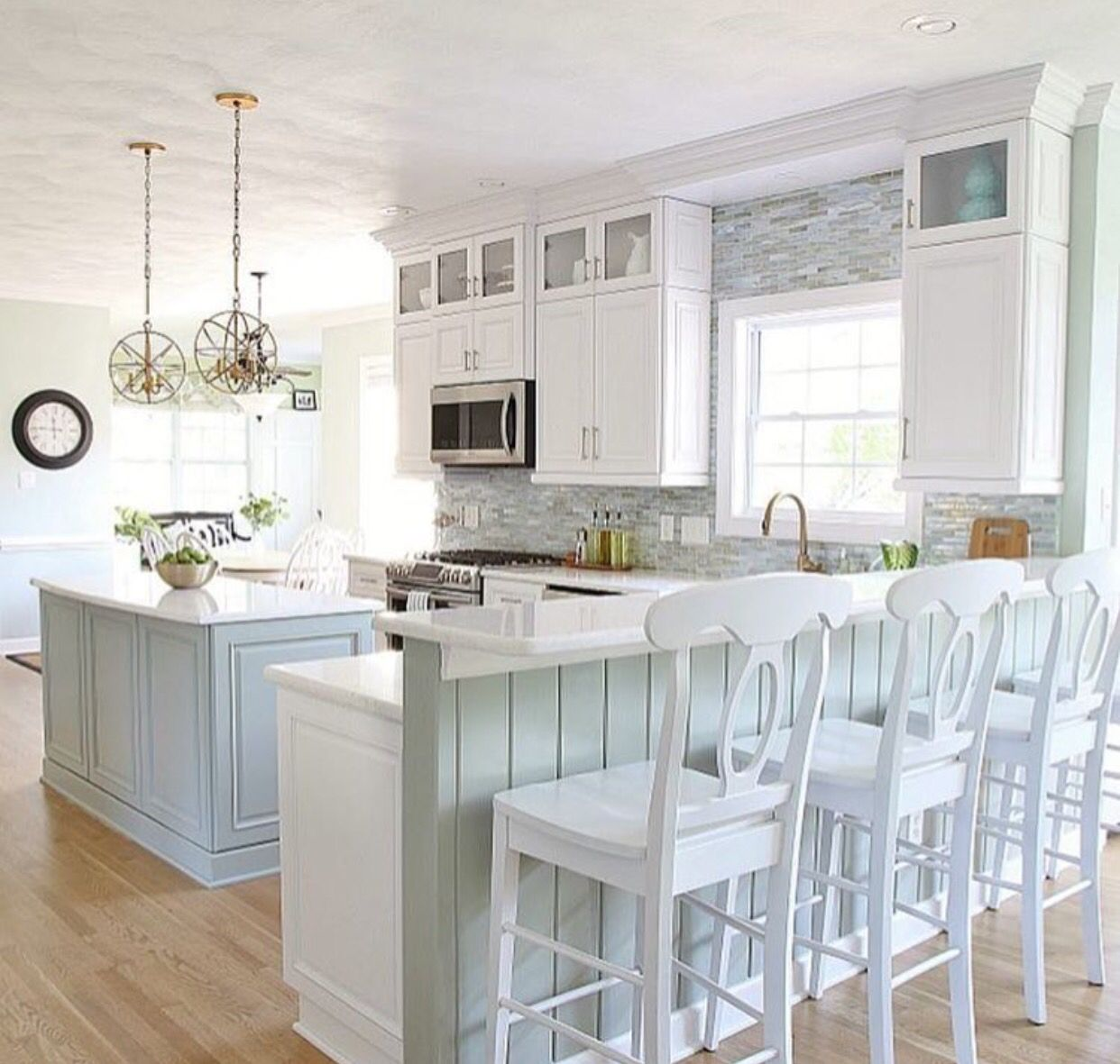 Beautiful soft blue pastel island with white perimeter cabinets ...