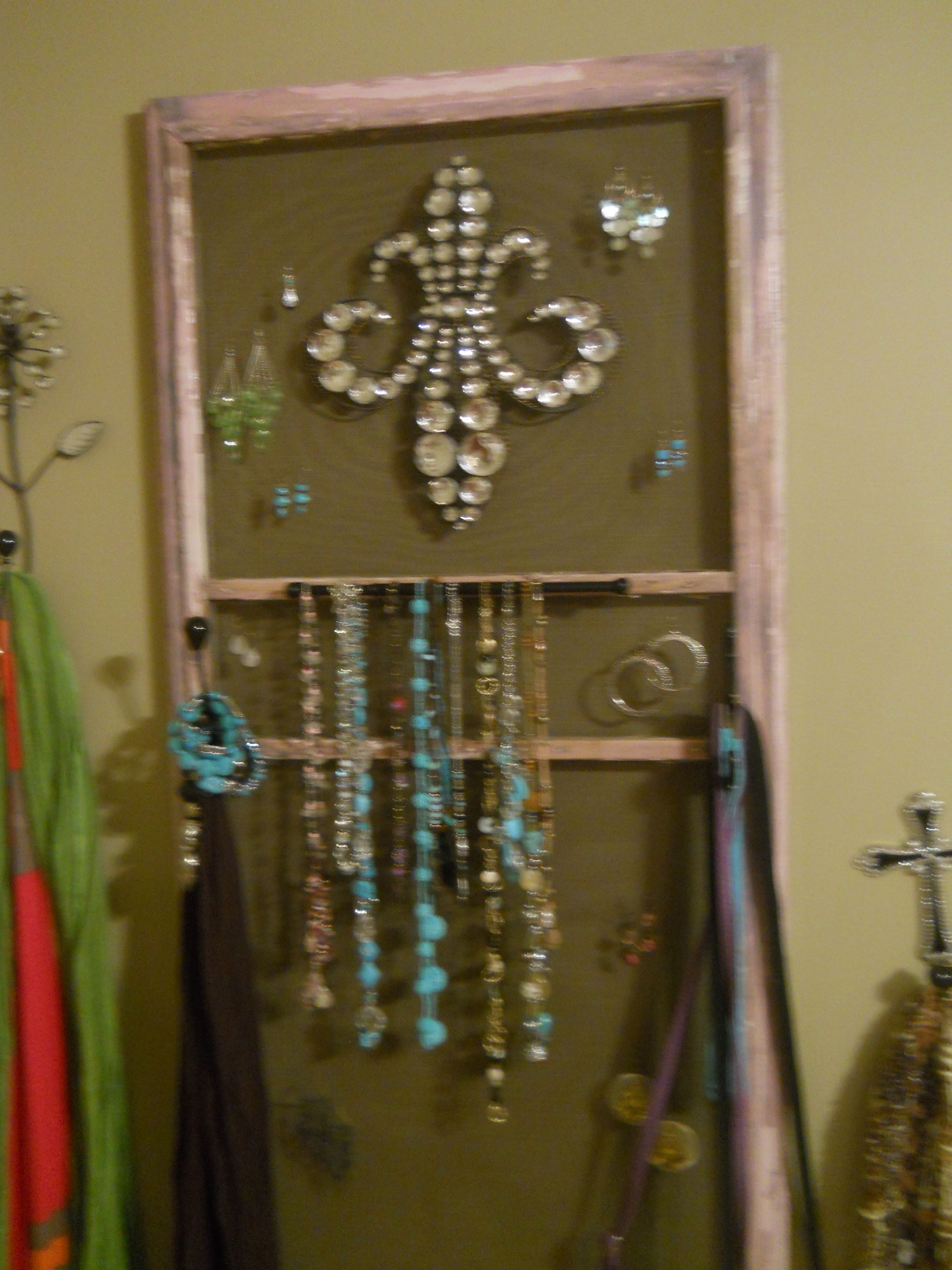 Creative jewelry holder My sister made this from an old screen door