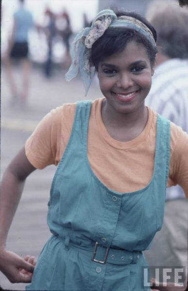 80's Janet Jackson! How cute w/ her throwback dress, tee and scarf headband! via LIFE Magazine.