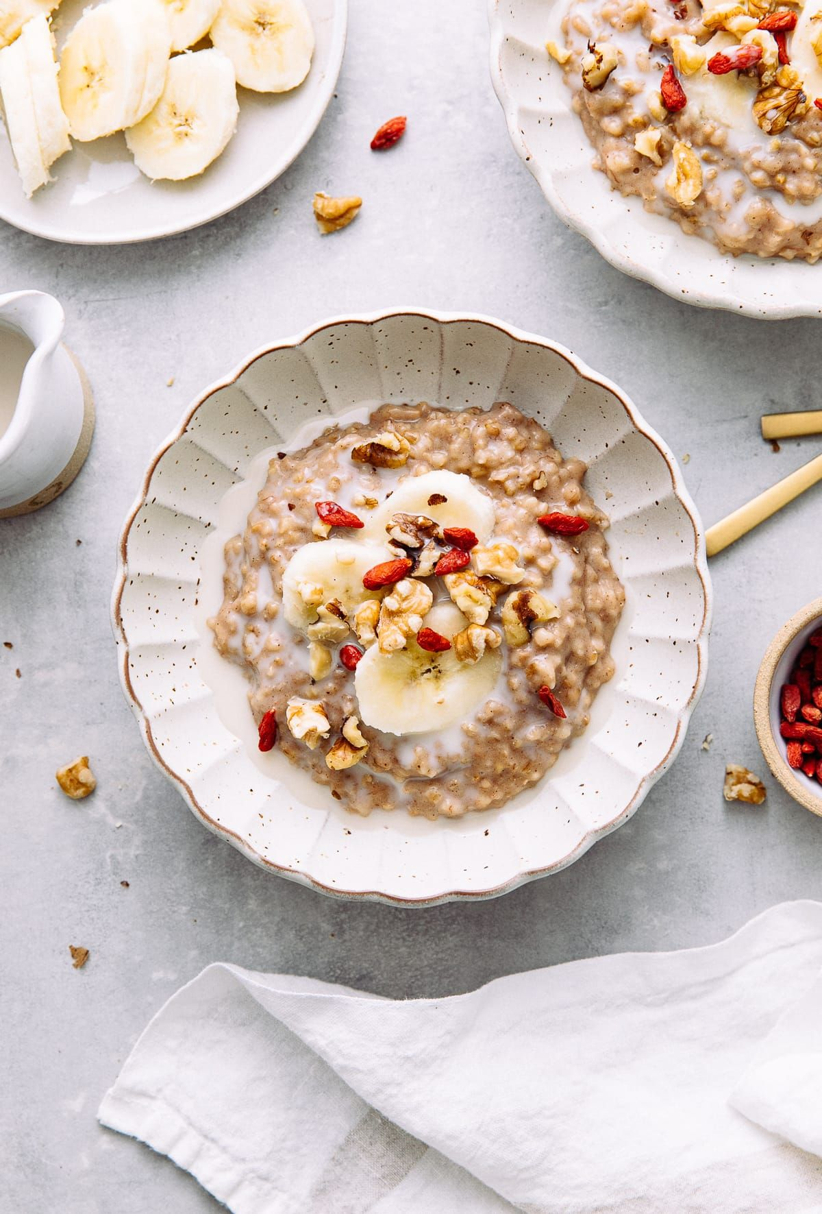 Slow Cooker Overnight Steel-Cut Oatmeal recipe with almond milk, bananas, cinnamon, vanilla and naturally sweetened with pure maple syrup is a healthy and delicious way to start your day! #overnightsteelcutoatmeal #healthyrecipes #veganrecipes #plantbased #steelcutoatmeal #steelcutoats