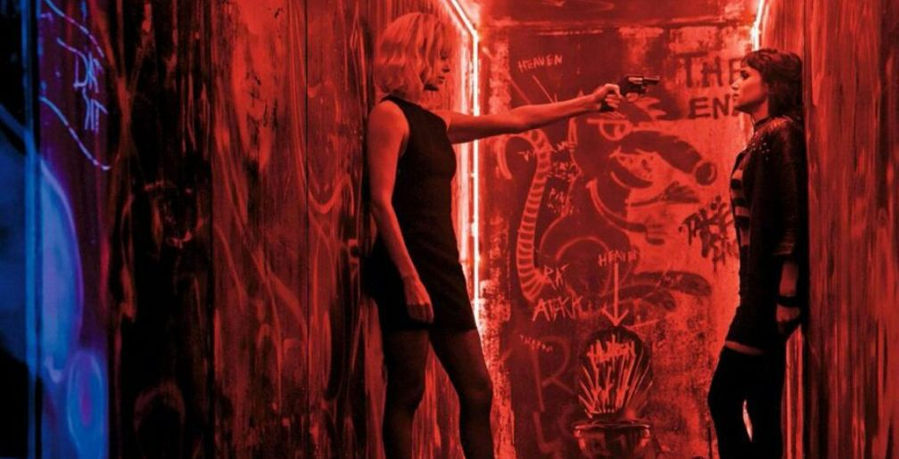 """Charlize Theron & Sofia Boutella Get Cozy In The Latest Clip From """"Atomic  Blonde"""""""