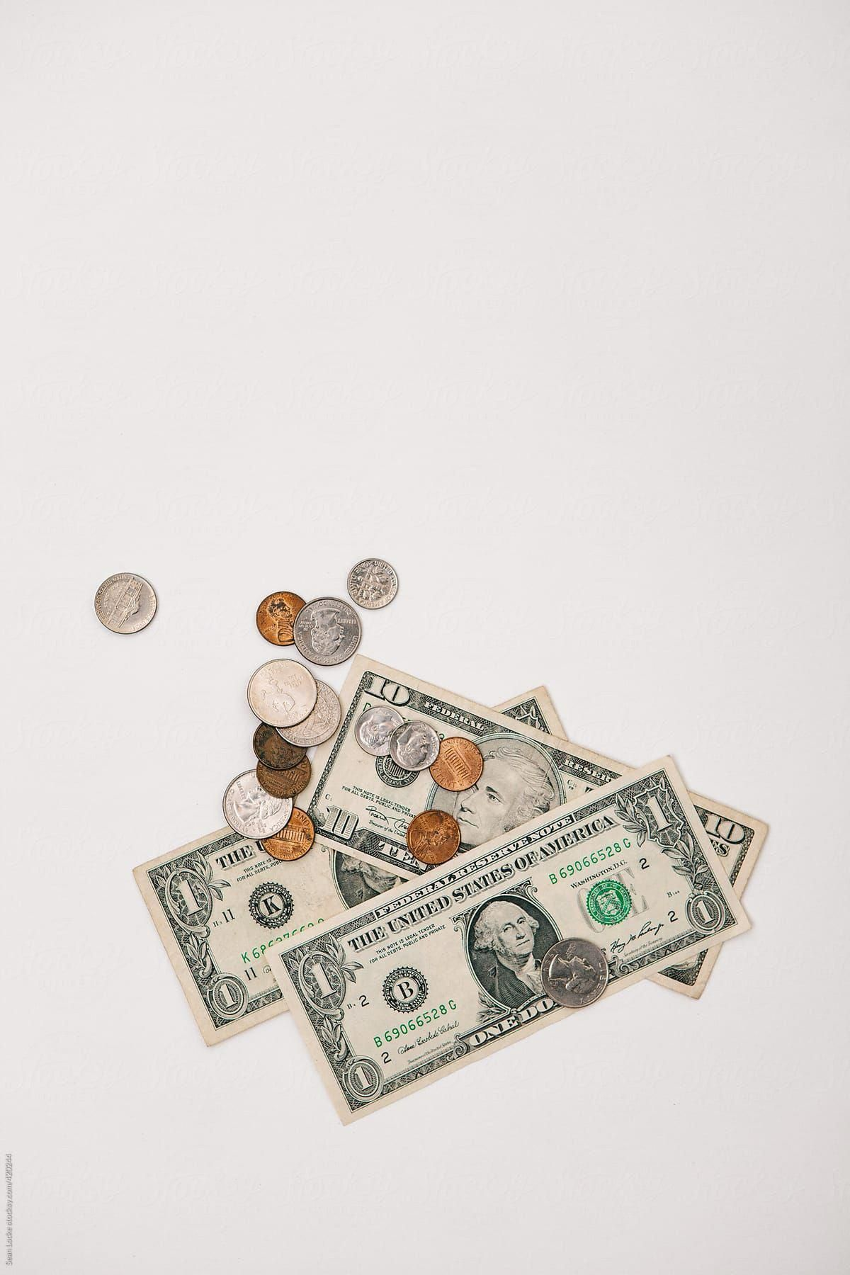 White Scattering Of US Currency And Coins by Sean Locke