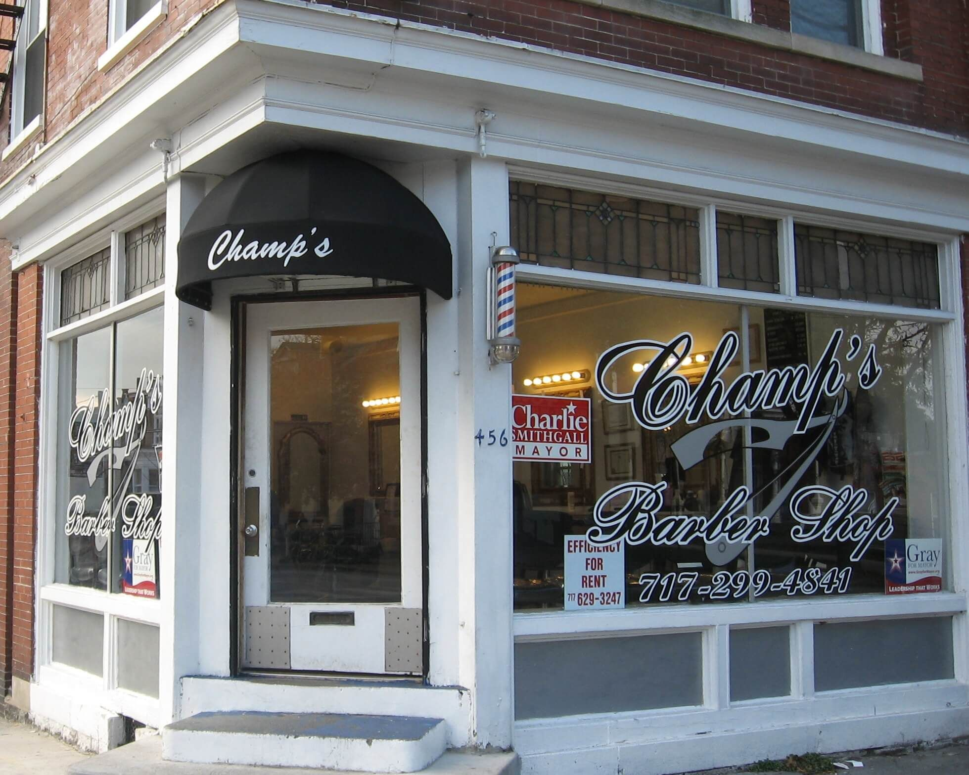 Round Door Awning With Name Of Barber Shop Applied To Flat Valance Shop Awning Barber Shop Shop Doors