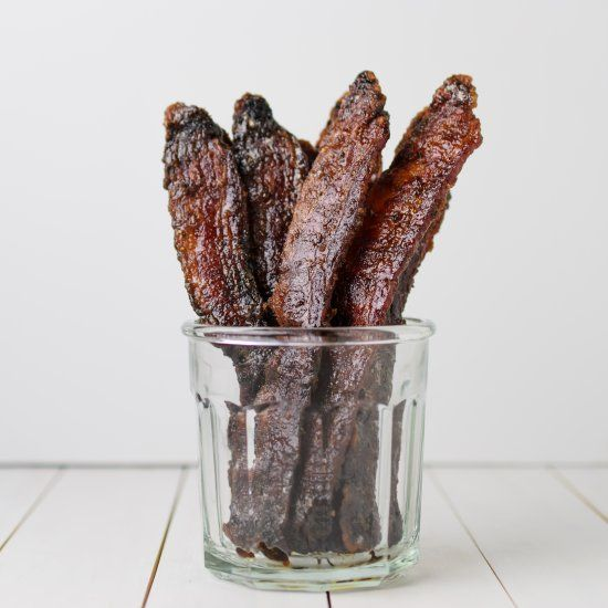 Thick-sliced bacon is glazed with dark brown sugar, cayenne pepper, a dash of cinnamon, and then roasted. An amazing combination.