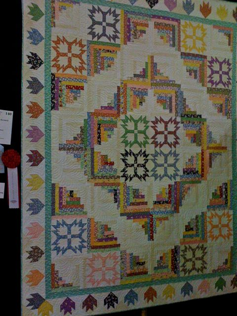 """""""Thirties Revisited"""" by Sue Jones -- The pattern is from """"Log Cabin Quartet Book"""" revised by Noella Kalal. Machine quilted by Cyndi Herman."""