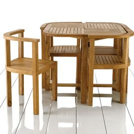 compact furniture. Round GARDEN Table With Four Slide Under Chairs | Plus 4 Garden Furniture By John Jenkins Compact A