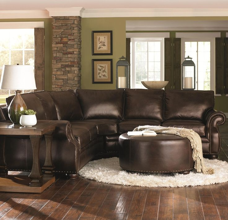 Chocolate brown leather sectional w round ottoman for Brown couch living room