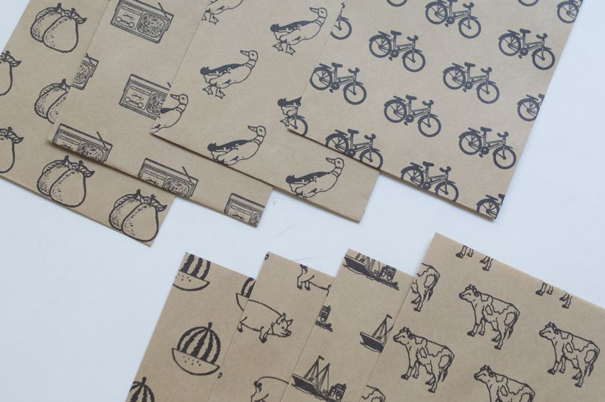 こちらはナチュラル×ブラック。手触りに味のある紙質です。br / 左上から洋梨・ラジオ・アヒル・自転車。br / 左下からスイカ・ブタ・船・牛、の上の写真と合わせた計16柄。